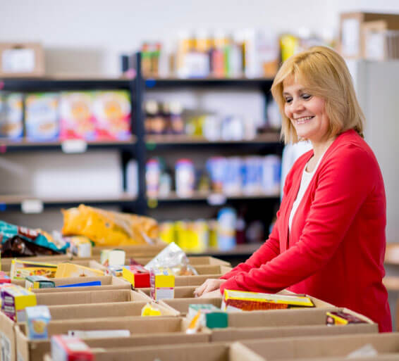 person sorting food in boxes